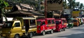 Tuk tuks parked on Patong's Beach Road